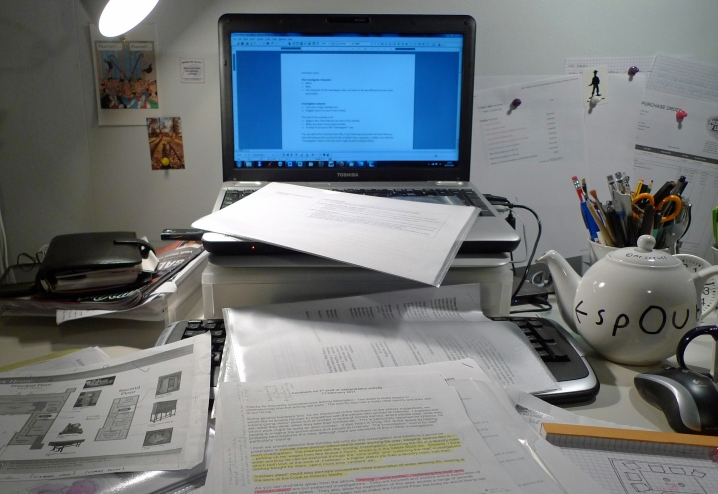 Desk, teapot, too many bits of paper